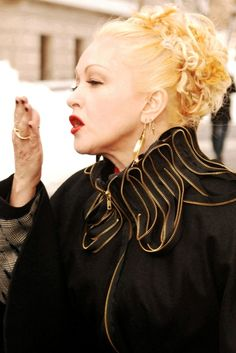 Cyndi Laupers platinum blonde updo