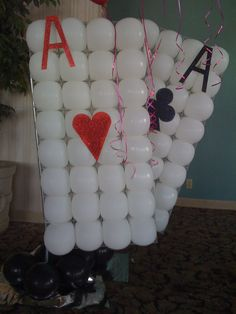 Playing cards made of balloons make a great conversation piece, photo backdrop or a perfect entrance to your casino party.