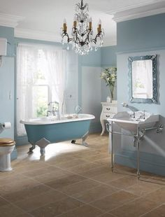 A chandelier in the bathroom?!  Can't decide if I love it or hate it. . . but it caught my eye!