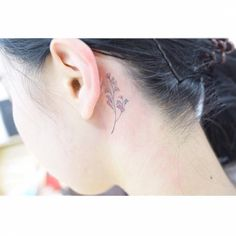Baby's breath tattoo behind the left ear.