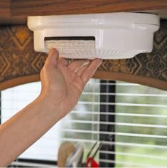 Get a ceiling-mounted paper plate dispenser. | 44 Cheap And Easy Ways To Organize Your RV/Camper