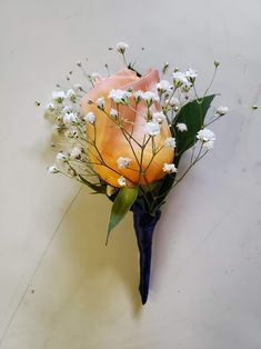 Peach roses, baby's breaths, and green leaves with navy trim. Corsages, Boutonnieres, Green Leaves, Roses, Peach, Navy, Plants, Pink, Peaches