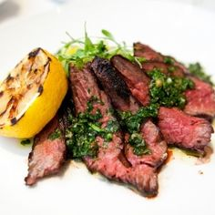 Charred hanger steak with crushed potatoes, grilled lemon, and salsa verde from Boulud Sud in NYC.