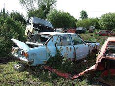 An old rusty Mazda 818 in the scrapyard.