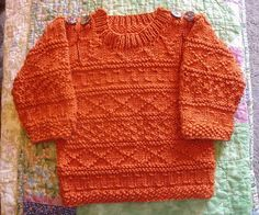 Easy Baby Aran sweater by Sarah Hoffman-KnitNet 2009 free pattern.