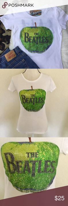 "The Beatles Apple Rhinestone T-shirt Abbey Road M The Beatles Tee in women's size medium with colorful gemstone green Apple Records logo.   The shirt has the famous Abbey Road image inside so when wearing the T-shirt, you can see the shadow through The Beatles on the back. Super cool.  Fitted style, sized for medium up to size 6  Gently used with some pilling and very light underarm stains, see last pic.  Approximate flat lay measurements  Across the armpits 17"" Waist 15"" Length 23.5""  💯% Cotton Outpost Trading Company Tops Tees - Short Sleeve"