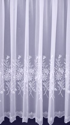 'Beth' Floral and fresh voile. Scalloped edge with delicate embroidery  Price per metre from: £4.79 Product Code: 12161-A1 Colour: White