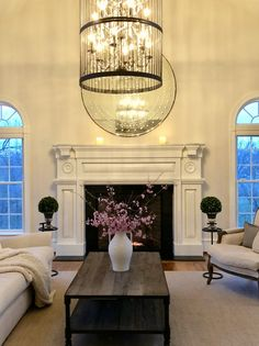 Cherry Blossom branches, evergreens, and a fireplace make a perfect evening.