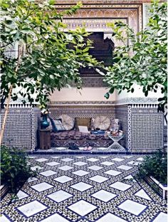 really cool outdoor area. with an awesome tile pattern.