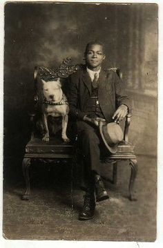 Vintage photo of a handsome man with his handsome pit bull