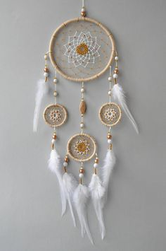 """Dream catcher """"Frappuchino"""". Tender and graceful wall hanging in сhampagne and milky coffee hues. Decorated with bright glass pearls and snow-white feathers."""