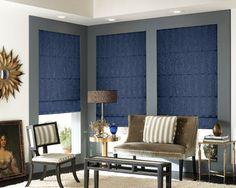 #Blue #romanshades with satin stripes are a #classy compliment to #moderndecor. #grayandblue #stripedchair #blueshades #windowtreatments #livingroom
