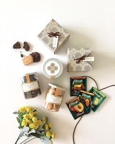 Eid Mubarak hampers PO EXTENDED until the 19th of June! - Each box contains: 1 box of mixed treats 1 box of mixed dilmah teas (12 teabags) 1 jar of cheesy almond cookies 1 jar of choconut oatmeal cookies 1 jar of palm fruit - • IDR 350.000 • - Free delivery within Surabaya area. #lebaranhampers #eidmubarakhampers #idulfitrihampers #parcellebaran #design #packagingdesign #gold #green