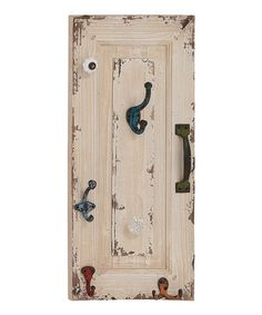 You could so do this with re-purposed cabnet door and some hooks and knobs.   Paint and distress it to make look vintage.
