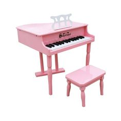 Classic pink baby grand piano with stool is designed to encourage a child start playing early.