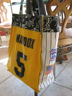 Baseball Bag for Mom made out of lil slugger's baseball uniforms.  Easy, Simple, Cheap.    http://coalhearted.blogspot.com/2012/01/for-love-of-baseball-moms.html