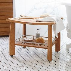 Spa Teak Shower Bench with Shelf from Frontgate comes with adjustable leg balancing screws!