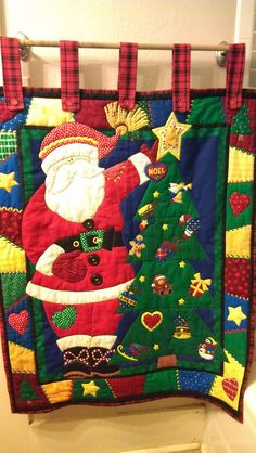 Santa wall quilt Hand Sewn with plaid red back.  This one is for sale for $85.00 Contact information at Handcrafted Creations Facebook page.