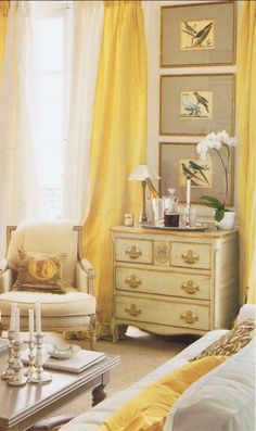 Myra Hoefer designed Paris apartment - gilded chest, gray matted prints, silver candle sticks, yellow and cream silk taffeta drapery with bleached burlap