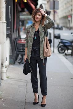 black jumpsuit with camo jacket spring casual outfit bmodish