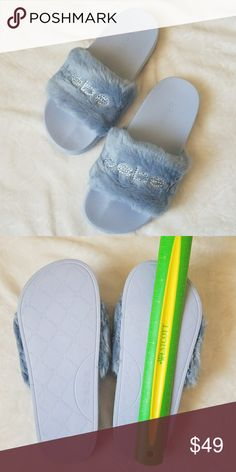 Light Blue BeBe Furiosa Slide Sandals Get a cute and casual style with bebe Furiosa Slide Sandals 😍  •Brand New  •Faux Fur Upper •Very comfy •Embroidered logo with rhinestone embellishments •Man made sole •Box included (may be a little damaged on the sides but it's still stands good)  Message me for any questions 🤗 bebe Shoes Sandals