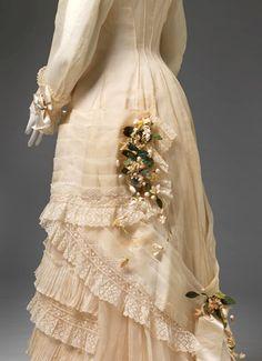 Wedding dress 1878 undefined 1. UNKNOWN, Australia; Wedding dress 1878, cotton, silk, wax, paper, Gift of Mr J. D. Oswald, 1970 (D54-1970)