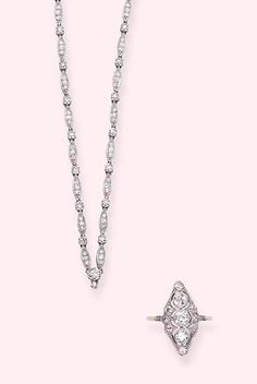 AN ART DECO DIAMOND CHAIN AND DIAMOND RING   The chain designed with diamond marquise and hexagonal-shaped links, with suspension hoop; the ring designed as a three-stone diamond vertical line, mounted in gold and platinum, both circa 1920