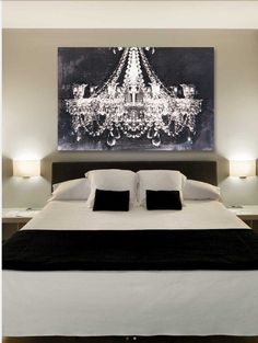 Chandelier art for black and white guest bedroom.