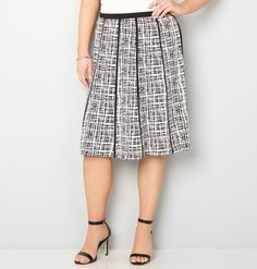 Get graphic in classic black and white. This pull-on panel skirt is piped with trim that gives you a twirl when you walk. A classic grid pattern is ideal for pairing with tops for a sophisticated work look.   Polyester/spandex. Machine wash. Imported.  Approx. 27 inches long.