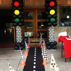 Love the stop light balloons and the floor race track for doorway entrance. Race Car themed party