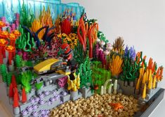 This set celebrates both - the incredible beauty of nature as well as the unbelievable versatility of Lego bricks. It is built on three base plates. This set would include: Two sharks, a stingray, a moray, some crabs, an octopus and a diver with scooter. Shark Lego, Legos, Lego Machines, Lego Challenge, Lego Sculptures, Lego Activities, Lego For Kids, Lego Modular, Pokemon