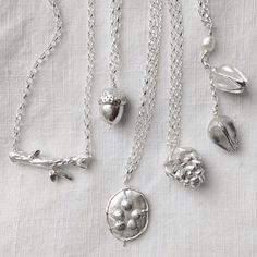 Part of my new Nature Table collection: fine silver twig, acorn, honesty seed case, pinecone and campion seed pod necklaces. On etsy soon #Padgram @silverpebble2
