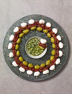 M&S Antipasti Skewers - Halkidiki olives, Semi-dried tomatoes, Creamy mozzarella with a green pesto dip Christmas Nibbles, Christmas Canapes, Christmas Buffet, Christmas Party Food, Easy Party Food, Snacks Für Party, Easy Canapes, Canapes Ideas, Wedding Canapes