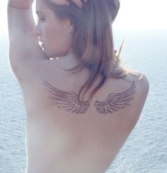 Wings tattoo, getting this