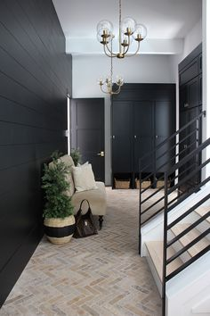 Tricorn black by sherwin Williams…. mudroom with black shiplap walls black ca… Tricorn black by sherwin Williams…. mudroom with black shiplap walls black cabinets brick herringbone floors Style At Home, Planchers En Chevrons, Brick Flooring, Brick Pavers, Brick Tile Floor, Brick Floor Kitchen, Entryway Flooring, Floors Kitchen, Modern Flooring