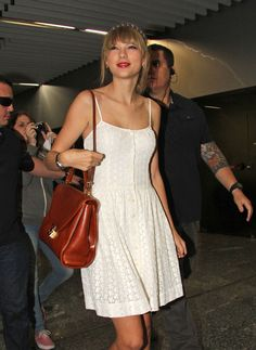 Taylor Swift Day Dress - How adorable is Taylor's summery white eyelet dress? . . . Taylor Swift Leather Shoulder Bag - Taylor toted her things in this classic cognac Cuoio Scottie Datchel.  Brand  - Mark Cross.