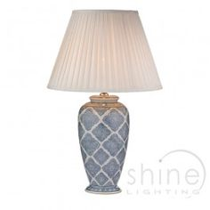 Ely ELY4223 1 Light Table Lamp, Dar Lighting. Traditional ceramic table lamp.  Finished with a decorative pale blue geometric print design.  Operated by rocker switch for easy on/off   Double Insulated (Class II)   1 x 60w BC GLS bulbs (Not Included)  Height: 63cm  Diam: 38cm  Need a shade?   Fine cotton ivory tapered pleat empire shade sold separately (see below).   Height: 30cm   Diam: 43cm  (base only) £95.00