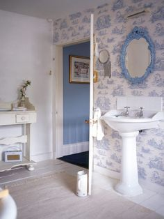 Pastel Blues Scenic Toile Wallpaper And A Delicately Carved Mirror Make For Dainty Feminine Bathroom