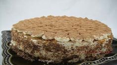 """Tiramisu– An Italian classic cake. Moist sponge cake/ladyfingers soaked with dark coffee/rum syrup filled with mascarpone cheese filling sprinkled with cocoa powder!!! There are many variations of making """"tiramisu""""… Different flavorings can be used; coffee flavor is replaced with all..."""