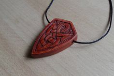 Wooden pendant in celtic style. At back side I can carve any rune you want. Unisex. So you can choise this pendant as a good present for you man or friend) Last photo - as example how runes will looks.   Size: 1.2 inch * 1.8 inch ( 30 mm * 45 mm)