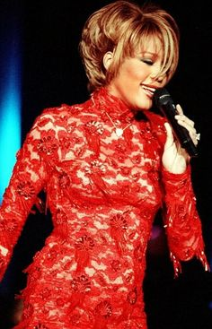 Whitney Houston in Marc Bouwer couture red lace ensemble