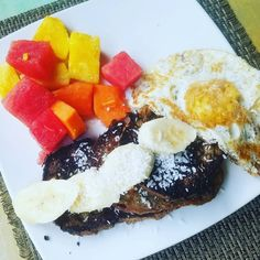 Epic tropical breakfast French Toast with Banana and Coconut Fresh Fruit and Fried Egg on the side #nomnom #tasty #grinds #chicasurf #chicasurfadventures @funky.monkey.lodge