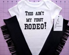 This Ain't My First Rodeo one piece bodysuit w Black Fringe Leg warmers Cowboy Chaps Set Infant Baby