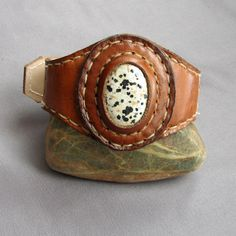 cuff with stone by art of spirit leatherworks