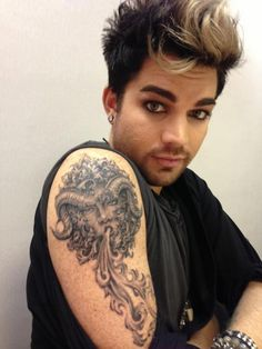 Adam's new tat - whoa...brown eye contacts?