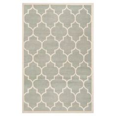 Hand-tufted wool rug in grey with a quatrefoil motif. Made in India.    Product: RugConstruction Material: WoolColor: Grey and ivoryFeatures:  Made in IndiaHand-tufted Note: Please be aware that actual colors may vary from those shown on your screen. Accent rugs may also not show the entire pattern that the corresponding area rugs have.Cleaning and Care: Professional cleaning recommended