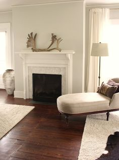 Benjamin Moore - Titanium Look how lovely Titaniium is with the warm wood and fresh white paint of the trim.  It creates light in a room.