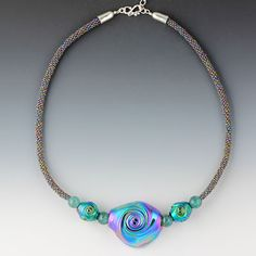 "Cosmos Collection ""Infinity""-- Art glass and apatite beads on hand-woven cord of tiny Japanese glass seed beads with hand-cast end caps, safety clasp, extension chain all in Argentium Sterling Silver"