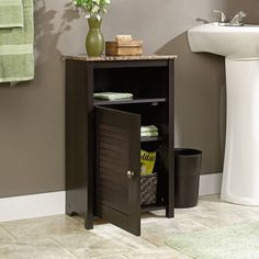Give your bathroom a functional appeal with this Bathroom Cabinet. The cabinet is constructed from engineered wood that makes it sturdy and long lasting. It has a cinnamon cherry finish that lends a gorgeous touch to the decor. The cabinet has open shelves that can be used to organize your bathroom essentials or decorative. It also has a reversible door behind which there are adjustable shelves that can be used to keep other items. The cabinet is heat-, stain- and scratch-resistant that…