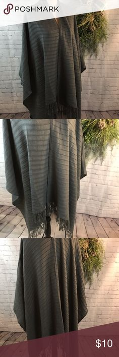 Ladies Sweater Shawl/Poncho/Wrap Fringe Trim Gray One Size fits all sweater/shawl/poncho/wrap.  Fringed edging and fits over shoulder.  Wide and long for any fit.  Gray color. Overall condition is good but it does have one pulled spot (see last picture). Sweaters Shrugs & Ponchos